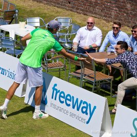LIVERPOOL, ENGLAND - Saturday, June 17, 2017: Robert Kendrick (USA) high-fives a spectator during Day Three of the Liverpool Hope University International Tennis Tournament 2017 at the Liverpool Cricket Club. (Pic by David Rawcliffe/Propaganda)