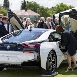 LIVERPOOL, ENGLAND - Thursday, June 21, 2018: Guests inspect a BMW i8 outside the corporate hospitality tent during day one of the Williams BMW Liverpool International Tennis Tournament 2018 at Aigburth Cricket Club. (Pic by Paul Greenwood/Propaganda)