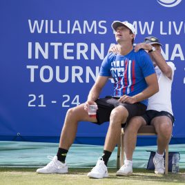 LIVERPOOL, ENGLAND - Saturday, June 23, 2018: Robert Kendrick (USA) gets a massage from a line judge during day three of the Williams BMW Liverpool International Tennis Tournament 2018 at Aigburth Cricket Club. (Pic by Paul Greenwood/Propaganda)